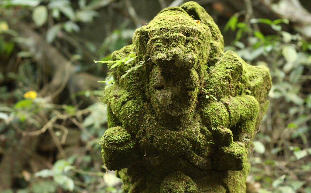 Mossy statue at temple