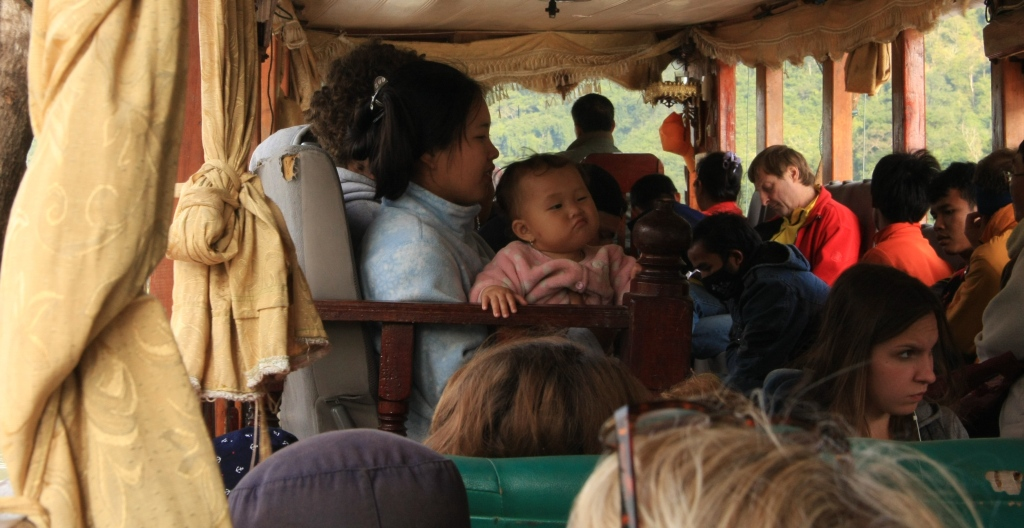 Laos family on the slow boat